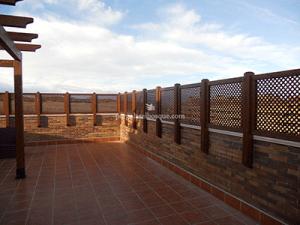 celosías de madera para terraza en azotea, provincia de Toledo, obra de 2013