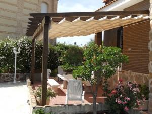 porche pergola con toldo en terraza